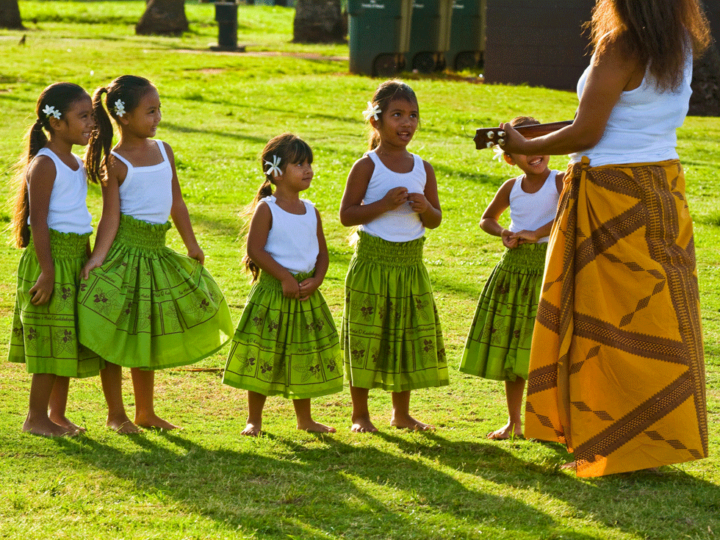 Young Keiki hula dancers meeting to practice