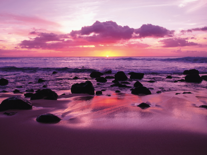 Sunset on beach in Molokai Hawaii